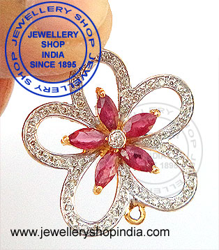 Pendant designs in gold diamonds and ruby gemstones.