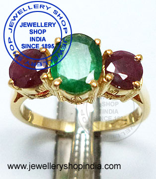 Emerald and ruby stone ring designs in gold for ladies.