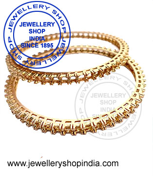 Bangle designs in emerald ruby sapphire gemstones in gold for ladies.