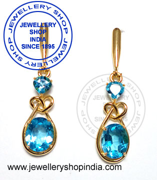 Gemstone earring designs in gold.