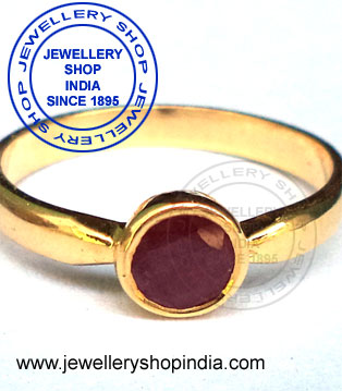 Order made birthstone ring designs in gold.