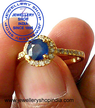 Blue Sapphire with Diamonds Ring Designs for Ladies